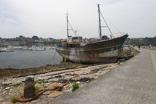 Fishing boat lying high and dry