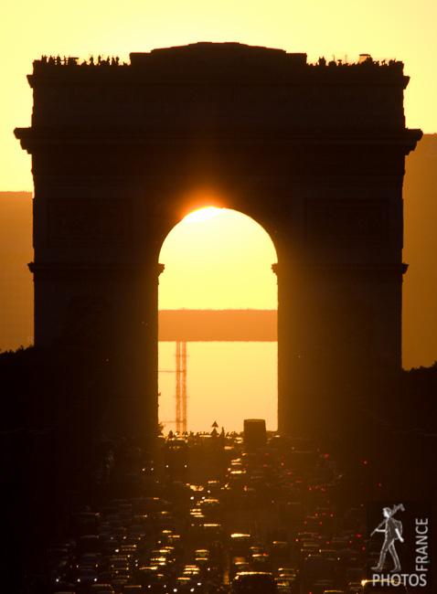 Sun under the Arc de Triomphe