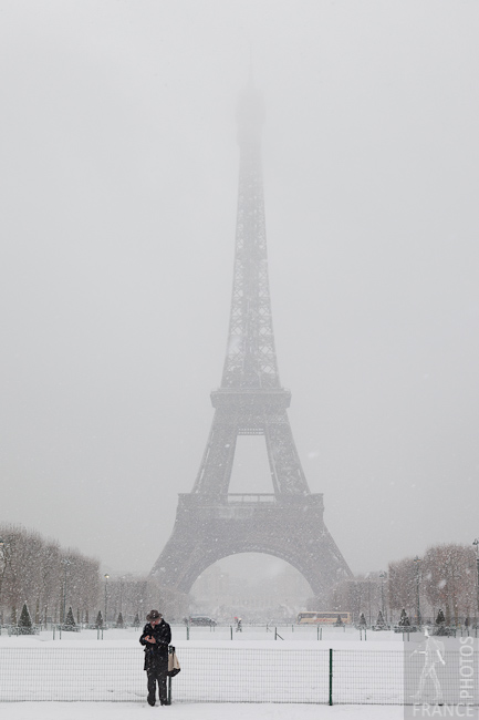 Snow falls on the tower