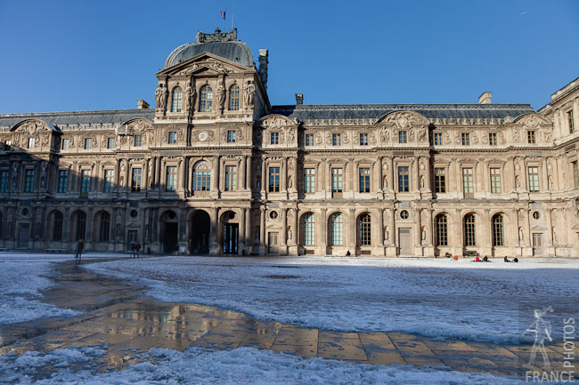 Louvre inner courtyard in snow