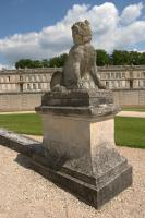 Guardian dog at the entrance of the Chantilly park
