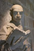 Monk reading a book (statue)